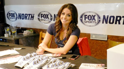 Kaylin signs a few autographs while waiting for all the Twins fans to arrive.