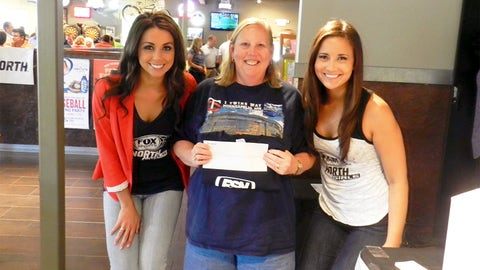 This lucky fan won tickets to an upcoming hometown sporting event.