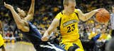 Thomas leads Marquette over Xavier 81-72