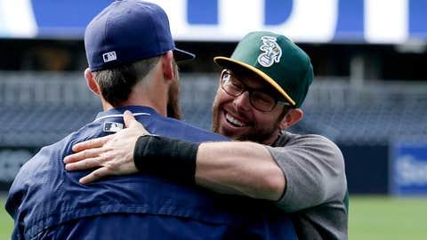 Old teammates share a hug
