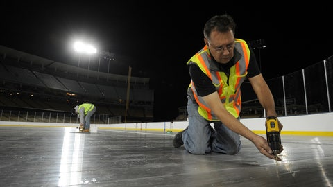 A general view of workers during the rink build for the 2014 Coors Light NHL Stadium Series game on January 16, 2014 at Dodger Stadium.