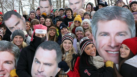 Jay and Dan from FOX Sports Live help Chyna and a group of fans cheer during the outdoor games at Hockey Day Minnesota.
