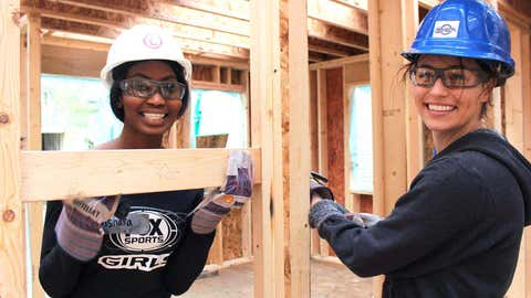 Bishara & Sage help block the cabinets that will be installed in the kitchen.