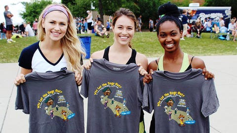 The FOX Sports Wisconsin Girls show off their official Brewers 5K t-shirts.
