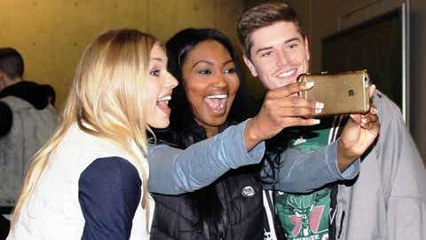 Let me take a selfie! The FOX Sports Wisconsin Girls pose for a pic with a Bucks fan.