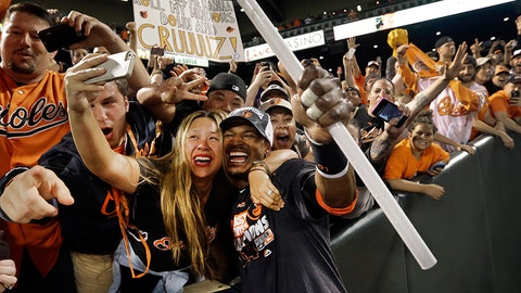 Orioles outfielder Adam Jones went into the stands for a photo