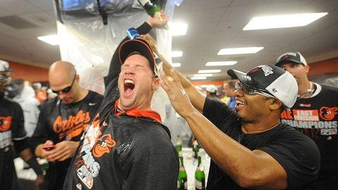 Orioles outfielder Alejandro De Aza gives pitcher Bud Norris a surprise