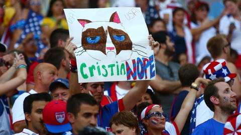 A USA fan holds a sign directed at Portugal forward Cristiano Ronaldo