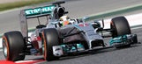 Hamilton edges Rosberg to capture pole for F1 Spanish Grand Prix