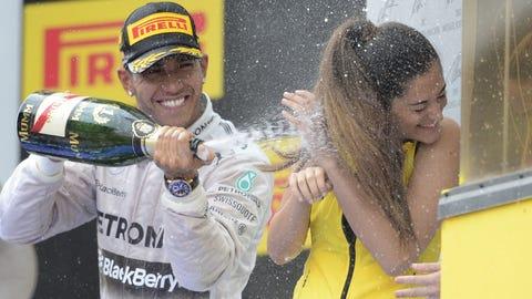 Podium girls getting sprayed with Champagne