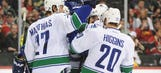 Booth's 2 goals lead Canucks to victory over Wild