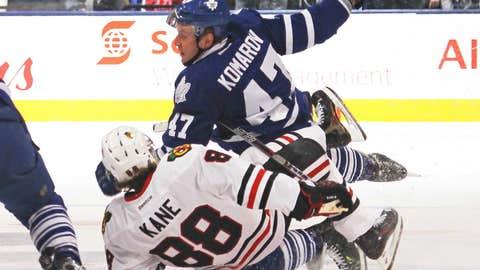 Kane's first career regular-season hat trick paces Blackhawks