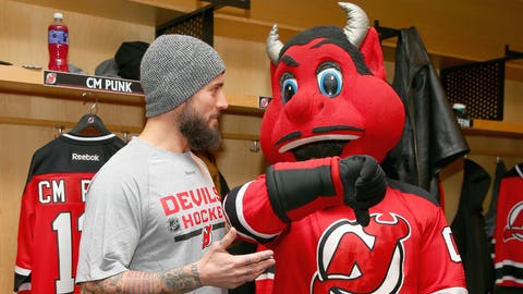 Former WWE champ CM Punk, Devils mascot lock horns