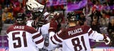 Latvia upsets Swiss, will face Canada in quarters