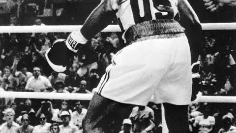 Leon Spinks pounds way to top of podium