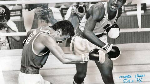 Michael Spinks grabs the gold