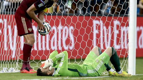 Akinfeev spills, Russia cleans up