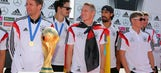 Germany's World Cup-winning squad returns home from Brazil