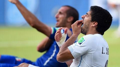 Luis Suarez bites Giorgio Chiellini during the 2014 World Cup