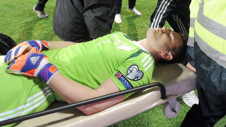 Russia goalkeeper Akinfeev fit again after being hit by flare