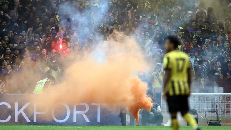 Malaysia's WCQ with Saudi Arabia suspended over flares on field