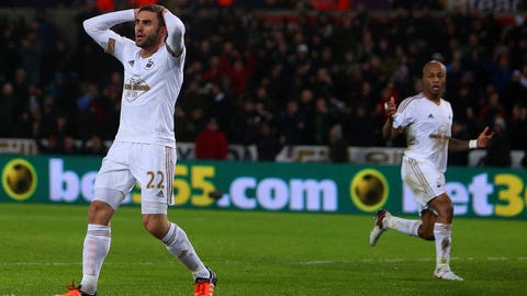 Swansea City dragged into the mire