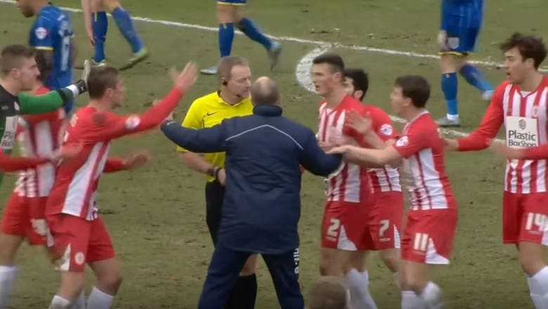 Referee whistles for halftime in the middle of an English team's goal