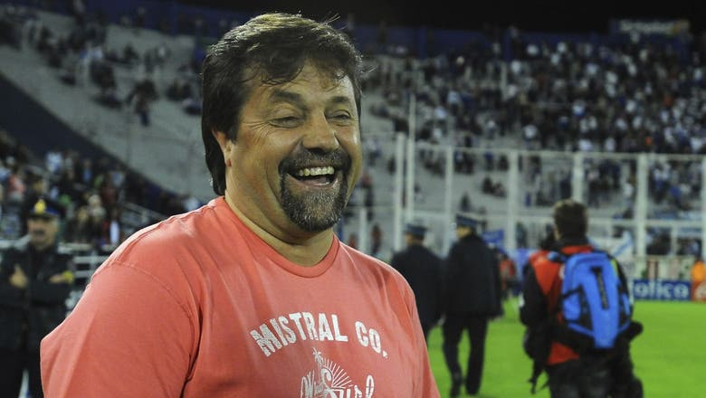 Argentinian manager brawls with own fans at a gas station