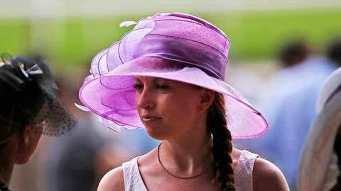 A race fan wearing an elaborate hat