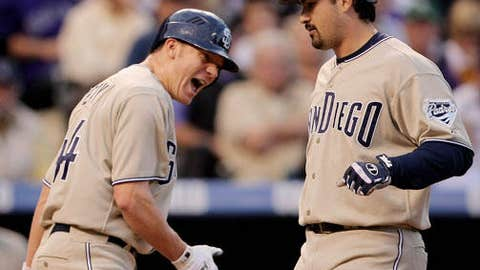 Slowing down: Former (Jake Peavy) and current (Adrian Gonzalez) Padres trade chips