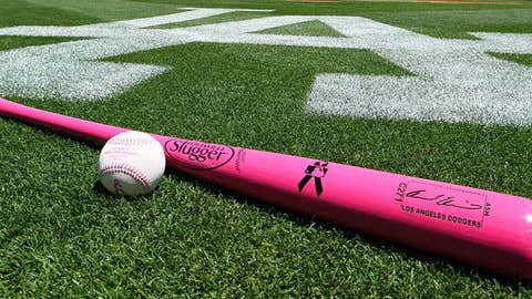 A general view of the official game ball for MLB games played Mother's Day and a pink bat