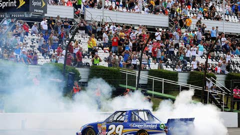 Ryan Blaney celebrates with a burnout after winning the NASCAR Camping World Truck Series