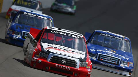 Timothy Peters races Ryan Blaney and Sean Corr during the NASCAR Camping World Truck Series