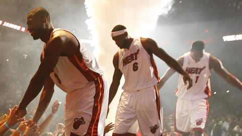 Dwyane Wade #3 and welcome LeBron James #6 and Chris Bosh #1 (Photo by Issac Baldizon/NBAE via Getty Images)