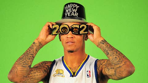 Golden State Warriors Monta Ellis wears a New Years hat and glasses