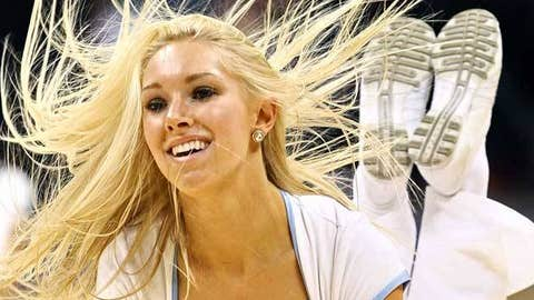 Denver Nuggets dancer performs in the second half of the game