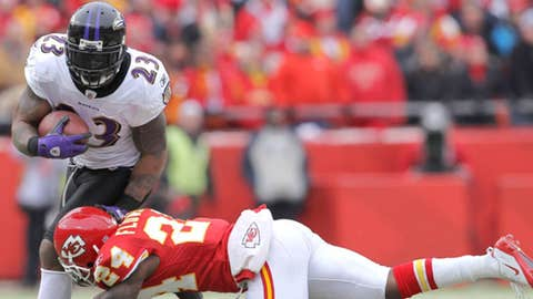 Running back Willis McGahee #23 of the Baltimore Ravens breaks a tackle by cornerback Brandon Flowers #24 of the Kansas City Chiefs