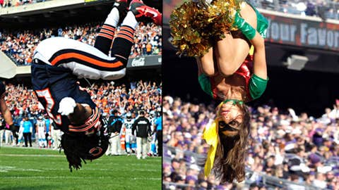 Marion Barber #24 of the Chicago Bears celebrates and A member of the Baltimore Ravens cheerleaders preforms in Halloween costumes