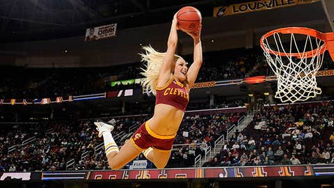 A member of the Cleveland Cavaliers dance team flies in for the dunk