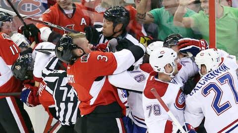 Montreal Canadiens players and Ottawa Senators players (AP Photo/The Canadian Press, Fred Chartrand)