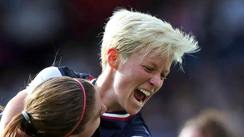 Alex Morgan #13 of USA is congratulated by Megan Rapinoe