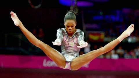 Gabrielle Douglas (USA) competes in the women's gymnastics uneven bars