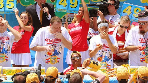 Tim Janus, Joey Chestnut, Matt Stonie and Bob Shoudt compete in the Nathan's Famous Fourth of July Hot Dog Eating Contest