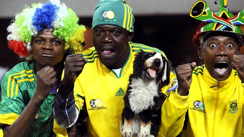 South African supporters pose as they cheer