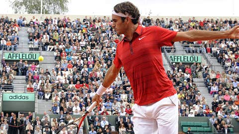 Switzerland's Roger Federer returns the ball