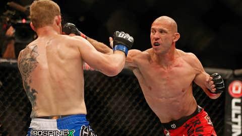 Donald Cerrone punches Evan Dunham
