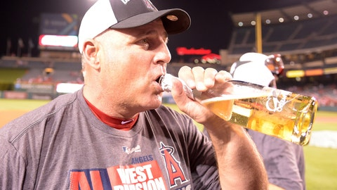 Skipper Mike Scioscia enjoys a championship beer