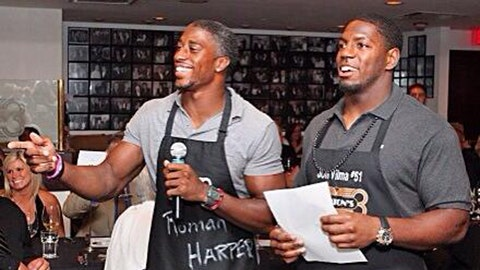 Roman Harper and Jonathan Vilma get to work