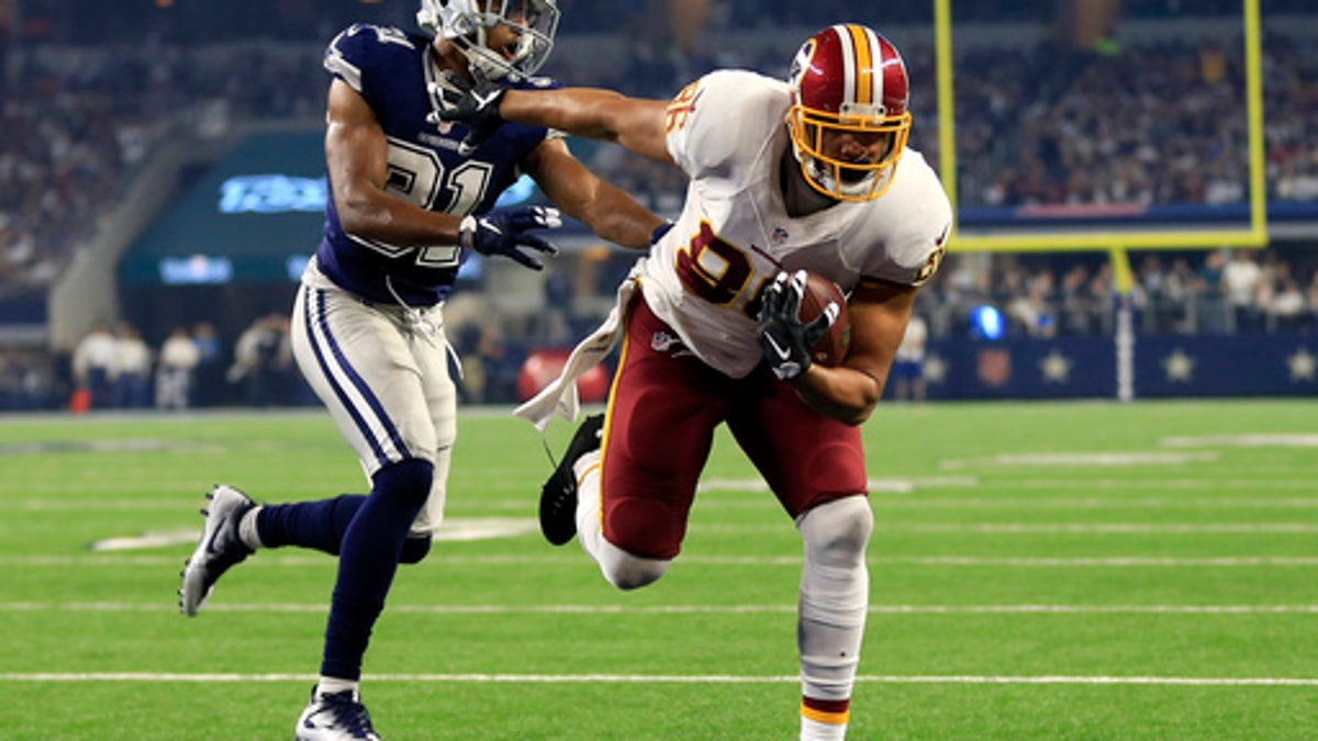 Jordan Reed's Thanksgiving Day dominance was accomplished with a separated shoulder.