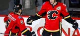 Monahan scores in OT, Flames get first win of season